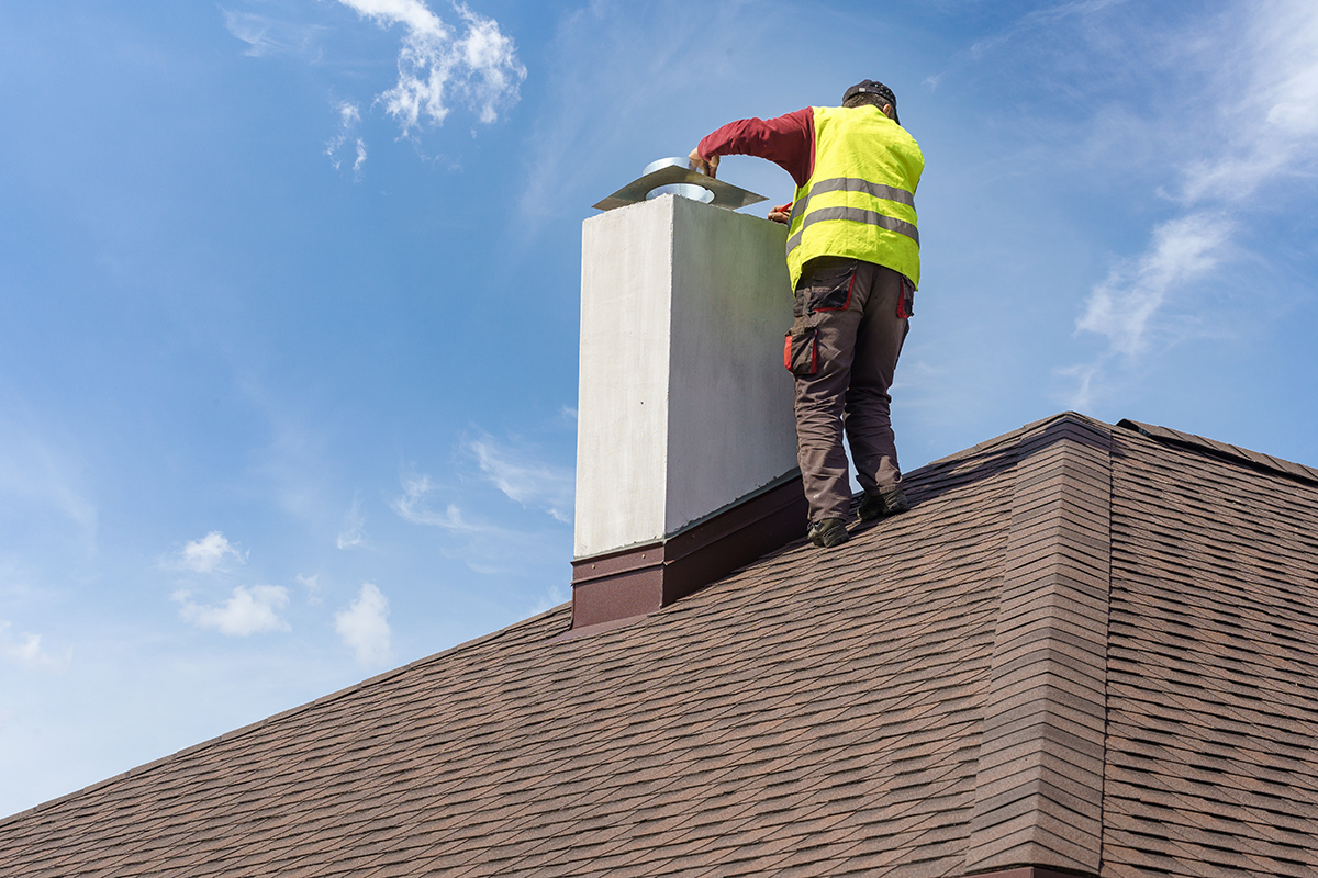 Man Performing Chimney & Roof Inspection